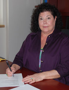 Denise Henning signs policy