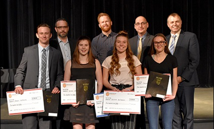 Winners and judges from the regional business pitch competition pose with their awards