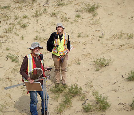 Ron Linowski and student on the sand dunes