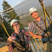 Patrick Tolchard and Krista Berg pose on a zipline platform